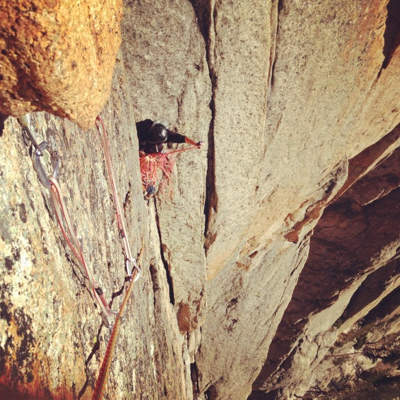 Here I am trying to untangle our mess of ropes at the top of pitch 2.